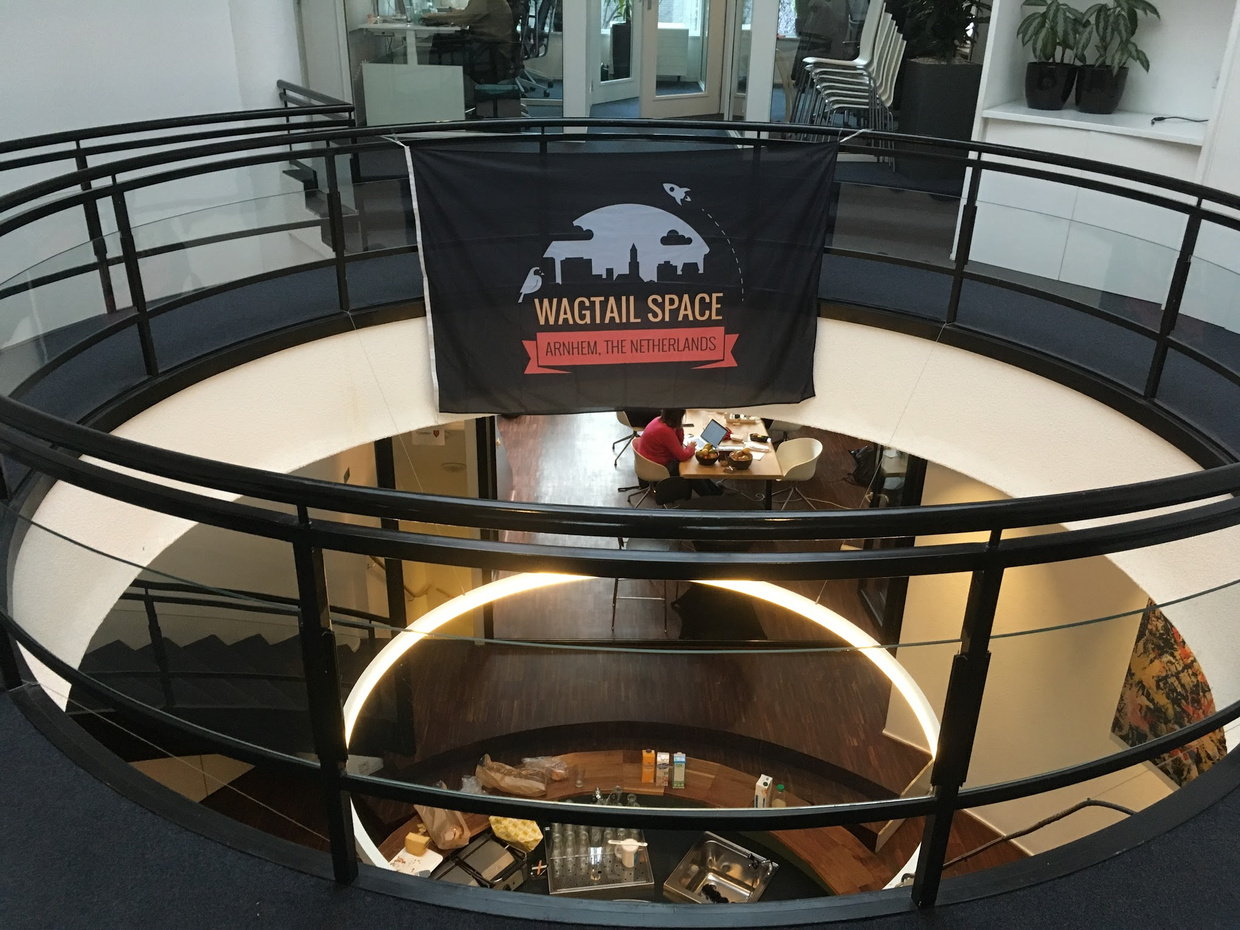 Photo of the Wagtail Space Arnhem venue, with the event's banner